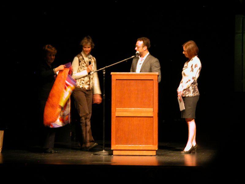 Marilyn Ulrich and Mary Ann Lisk present Mary Ann's quilt to Teddy Wayne while Kristi Miller looks on (1)