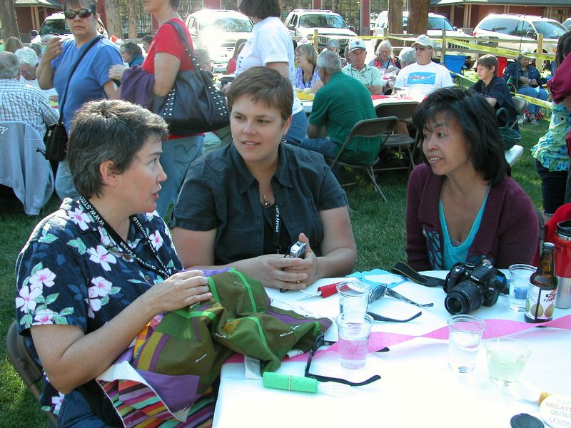 Friday night Picnic in the Park- Tonya teaches the finer points of hand quilting without a hoop (5)