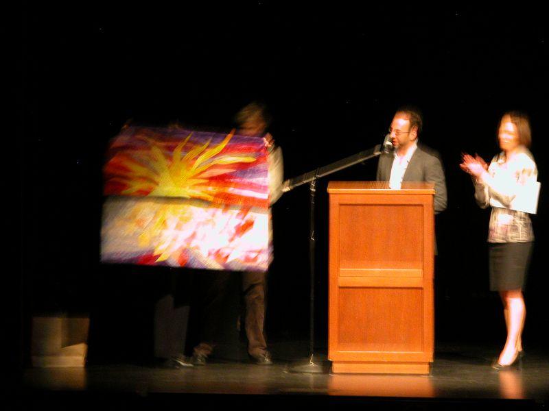 Marilyn Ulrich and Mary Ann Lisk present Mary Ann's quilt to Teddy Wayne while Kristi Miller looks on (4)